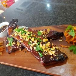 Sticky Jack Daniel's ribs, carrot & peanut salad