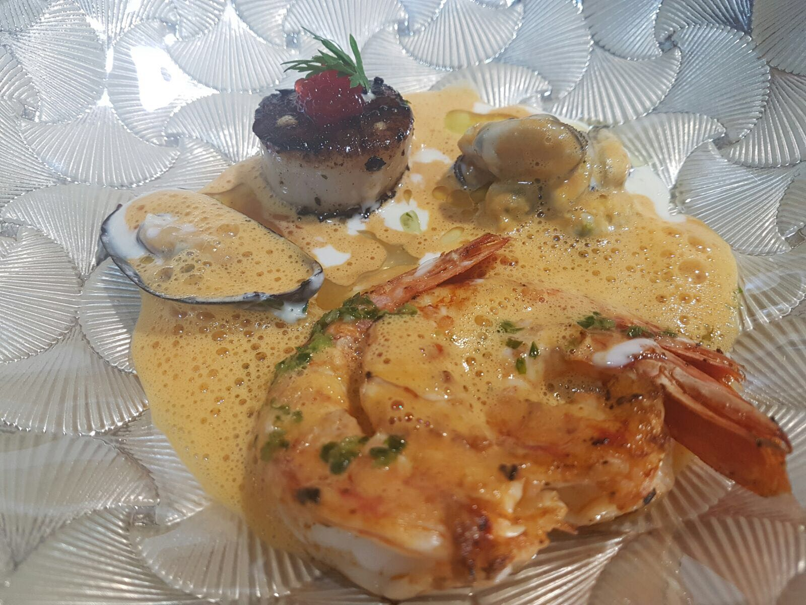Deconstructed bouillabaisse, hand dived scallop, mussels, gambas & lobster veloute