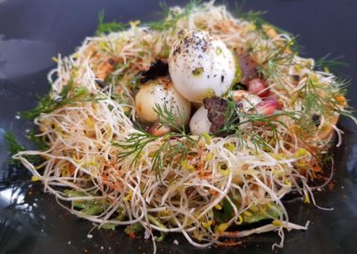 Quails egg birds nest, truffle dressing, asparagus shavings